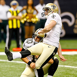 September 9, 2012; New Orleans, LA, USA; New Orleans Saints place kicker Garrett Hartley (5) kicks a field goal against the Washington Redskins during the second half of a game at the Mercedes-Benz Superdome. The Redskins defeated the Saints 40-32. Mandatory Credit: Derick E. Hingle-US PRESSWIRE