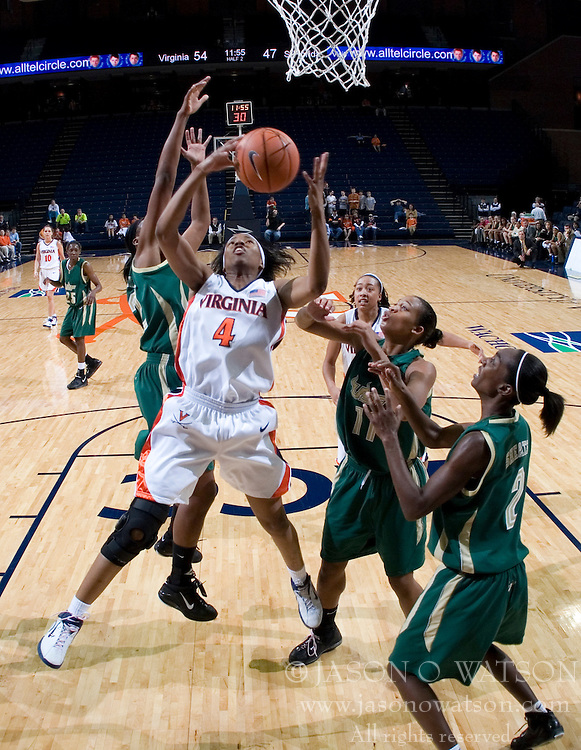 Virginia Cavaliers Center Siedah Williams (4) grabs a rebound against South Florida.  The Virginia Cavaliers defeated the South Florida Bulls 73-71 in the third round of the Women's NIT held at John Paul Jones Arena in Charlottesville, VA on March 22, 2007.