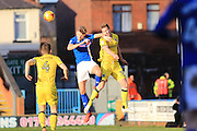 Mark Kitching challenged in the penalty area during the EFL Sky Bet League 1 match between Rochdale and Bristol Rovers at Spotland, Rochdale, England on 4 February 2017. Photo by Daniel Youngs.