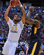 SAN DIEGO, CA - MARCH 16:  West Virginia Mountaineers forward Esa Ahmad (23) shoots against Murray State Racers forward Anthony Smith (24) during a first round game of the Men's NCAA Basketball Tournament at Viejas Arena in San Diego, California. West Virginia won 85-68.  (Photo by Sam Wasson)