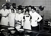 people group posing in large commercial kitchen Netherlands 1950s