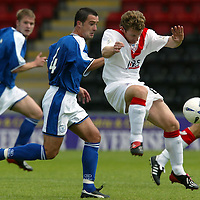 Airdrie v St Johnstone...07.08.04<br />Marvyn Wilson is tackled by David Hannah<br /><br />Picture by Graeme Hart.<br />Copyright Perthshire Picture Agency<br />Tel: 01738 623350  Mobile: 07990 594431