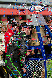 FONTANA, CA -  NASCAR and Nationwide driver Kyle Busch won at Auto Club Speedway for the second consecutive season, holding off rookie Kyle Larson by 0.214 seconds in a green-white-checkered finish. 23rd march 2014. Byline, credit, TV usage, web usage or linkback must read SILVEXHOTO.COM. Failure to byline correctly will incur double the agreed fee. Tel: +1 714 504 6870.