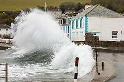 © Licensed to London News Pictures. 02/04/2018. St Austell, UK. A large wave crashes onto houses and the road at Portmellon, Cornwall. Cornwall experienced heavy rainfall overnight, causing rough seas, flooding and road closures across the county. Photo credit : Tom Nicholson/LNP