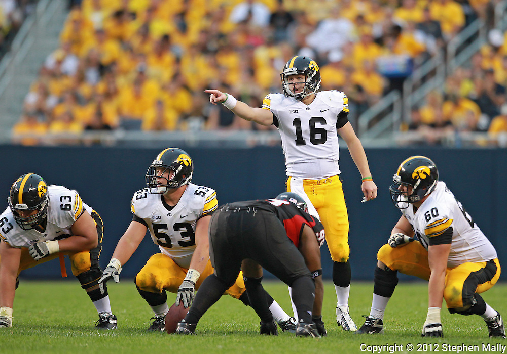 September 01 2012: Iowa Hawkeyes quarterback James Vandenberg (16) points to the defense as Iowa Hawkeyes offensive linesman Austin Blythe (63), Iowa Hawkeyes offensive linesman James Ferentz (53), and Iowa Hawkeyes offensive linesman Matt Tobin (60) wait for the snap during the second half of the NCAA football game between the Iowa Hawkeyes and the Northern Illinois Huskies at Soldiers Field in Chicago, Illinois on Saturday September 1, 2012. Iowa defeated Northern Illinois 18-17.