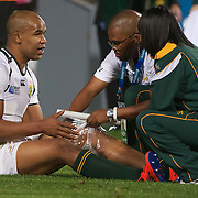 JP Pietersen, South Africa, is treated for injury at the end of the South Africa V Samoa, Pool D match during the IRB Rugby World Cup tournament. North Harbour Stadium, Auckland, New Zealand, 30th September 2011. Photo Tim Clayton...