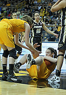 January 28, 2012: Iowa Hawkeyes center Morgan Johnson (12) helps Iowa Hawkeyes guard Samantha Logic (22) to her feet during the NCAA women's basketball game between the Purdue Boilermakers and the Iowa Hawkeyes at Carver-Hawkeye Arena in Iowa City, Iowa on Saturday, January 28, 2012.