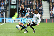 Sheffield Wednesday defender Jack Hunt and Derby County defender Marcus Olsson during the Sky Bet Championship match between Derby County and Sheffield Wednesday at the iPro Stadium, Derby, England on 23 April 2016. Photo by Jon Hobley.