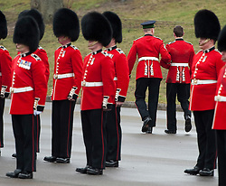 © London News Pictures. 17/03/2012. Aldershot, UK. A soldier being led away by officers after fainting at a St Patrick's Day parade at Mons Barracks in Aldershot, Hampshire, UK, on March 17th, 2012 which was attended by The Duchess of Cambride CATHERINE (KATE) MIDDLETON.  Photo credit : Ben Cawthra/LNP.