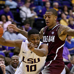 Jan 23, 2013; Baton Rouge, LA, USA; LSU Tigers guard Andre Stringer (10) drives past Texas A&M Aggies guard J'Mychal Reese (11) during the second half of a game at the Pete Maravich Assembly Center. LSU defeated Texas A&M 58-54. Mandatory Credit: Derick E. Hingle-USA TODAY Sports