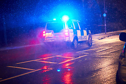 © Licensed to London News Pictures. 29/01/2019. STOKE MANDEVILLE, UK.  An ambulance with blue light flashing drives through light snow near Stoke Mandeville station. Rain is expected to turn to snow across large parts of the south of England and the Met Office has issued a yellow warning of snow and ice overnight.  Photo credit: Cliff Hide/LNP