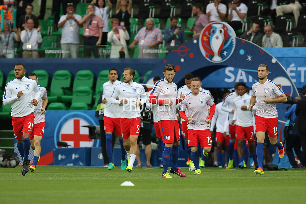 England players come to the pitch for warm up during the Euro 2016 Group B match between Slovakia and England at Stade Geoffroy Guichard, Saint-Etienne, France on 20 June 2016. Photo by Phil Duncan.