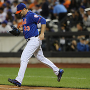 Pitcher Matt Harvey, New York Mets, jumps over the first baase line on the way to the mound during the New York Mets Vs New York Yankees MLB regular season baseball game at Citi Field, Queens, New York. USA. 20th September 2015. Photo Tim Clayton