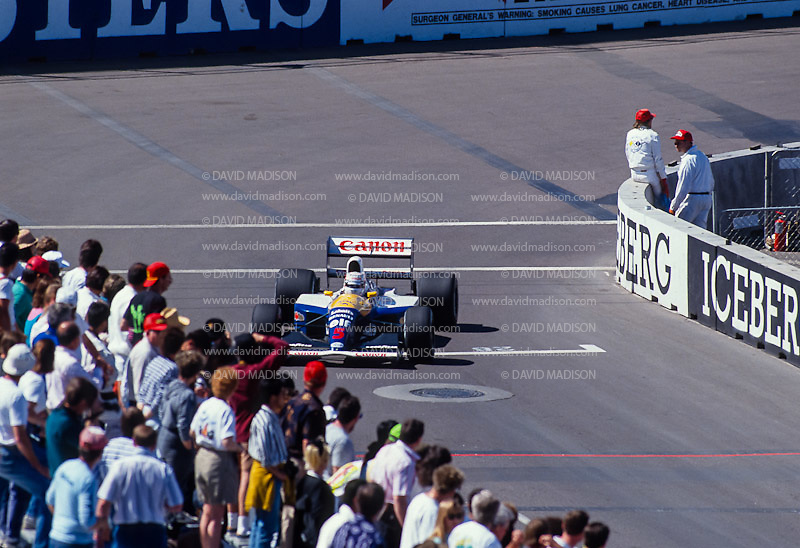 PHOENIX -  MARCH 1991:  Nigel Mansell of Great Britain and the Williams-Renault team rounds a corner during the Formula One United States Grand Prix held in Phoenix, Arizona in March 1991. (Photo by David Madison/Getty Images) *** Local Caption *** Nigel Mansell
