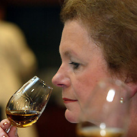 Scotch Whisky Association press conf..20.01.03<br />Secretary of State for Scotland Helen Liddell pictured nosing Famous Grouse whisky in the sampling room at the Edrington Groups Glasgow HQ.<br />See press release from David Williamson/SWA 0131 222 9230 or 07730 496151<br /><br />Pic by Graeme Hart<br />Copyright Perthshire Picture Agency<br />Tel: 01738 623350 / 07990 594431