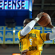 George Mason Forward Jonathan Arledge (5) pull down a rebound in the second half of a regular season NCAA basketball game against George Mason Saturday, March 2, 2013 at the Bob Carpenter Center in Newark Delaware.