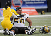 Justin Kemp, Hazelwood Central, is consoled by cheerleader Diamond Conner after the Hawks 10-7 loss to Rockhurst in the Class 6 State Championship Game.