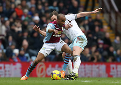 West Ham United's Kevin Nolan tackles Aston Villa's Fabian Delph - Photo mandatory by-line: Matt Bunn/JMP - Tel: Mobile: 07966 386802 08/02/2014 - SPORT - FOOTBALL - Birmingham - Villa Park - Aston Villa v West Ham United - Barclays Premier League