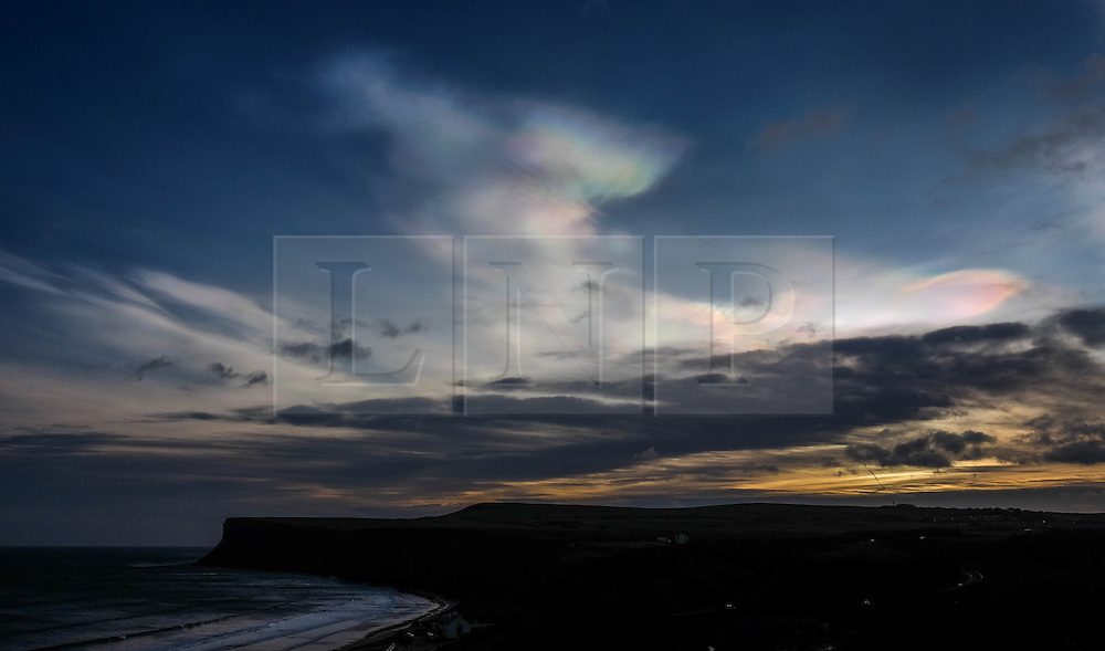 **CAPTION CORRECTION - Clouds in this image are Nacreous clouds, not Sirrus clouds stated in earlier captions** &copy; Licensed to London News Pictures.01/02/16<br /> <br /> Nacreous clouds, also known as mother-of-pearl clouds, give off an unusually array of colours over Saltburn-by-the-Sea. Nacreous clouds are seen mostly during winter at high latitudes like Scandinavia, Iceland, Alaska and Northern Canada and sit in the lower stratosphere some 15 - 25 km high, well above tropospheric clouds.<br /> <br /> Photo credit : Ian Forsyth/LNP