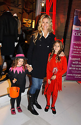 MELISSA ODABASH and her daughters left, AVALON de SANTIS and right ALAIA de SANTIS at a party to celebrate the launch of DKNY Kids and Halloween in aid of CLIC Sargent and RX Art held at DKNY, 27 Old Bond Street, London on 31st October 2006.<br />