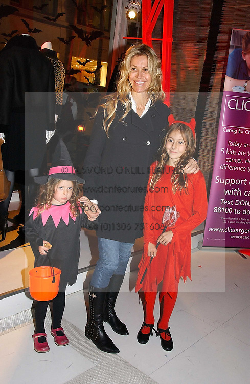 MELISSA ODABASH and her daughters left, AVALON de SANTIS and right ALAIA de SANTIS at a party to celebrate the launch of DKNY Kids and Halloween in aid of CLIC Sargent and RX Art held at DKNY, 27 Old Bond Street, London on 31st October 2006.<br /><br />NON EXCLUSIVE - WORLD RIGHTS