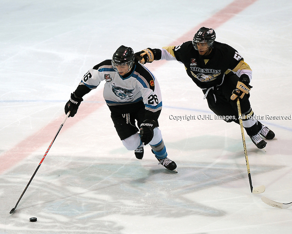 LINDSAY, ON - Feb 4 : Ontario Junior Hockey League Game Action between the Lindsay Muskies and the Trenton Golden Hawks, Shaquille Hickey #51 of the Trenton Golden Hawks Hockey Club grabs hold of Joseph Vocino #26 of the Lindsay Muskies Hockey Club during second period game action.<br /> (Photo by Andy Corneau / OJHL Images)