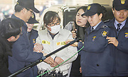 Choi Soon-Sil, a close friend of then South Korean President Park Geun-hye, arrives at the special prosecutors office in Seoul, South Korea, Feb 25, 2017. The special prosecutors started after President Park was impeached by the parliament in December, 2016 on allegations that her confidante Choi Soon-sil exerted influence on national affairs without any position in the administration as she was seeking to extort money from conglomerates, according to local media. Photo by Lee Jae-Won (SOUTH KOREA) www.leejaewonpix.com