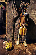 Kids from the favela of City of God love to fantasy as Bate Bola clowns. Still too young to get out and circulate out of the favela, they show in their neighborhood..