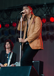 © Licensed to London News Pictures. 18/06/2015. London, UK.   The Strokes performing live at Hyde Park.   In this picture - Julian Casablancas (right), Nick Valensi (left).  Photo credit : Richard Isaac/LNP