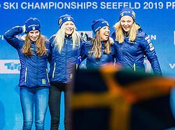 28.02.2019, Seefeld, AUT, FIS Weltmeisterschaften Ski Nordisch, Seefeld 2019, Langlauf, Damen, Staffel 4x5 km, Siegerehrung, im Bild Weltmeisterin und Goldmedaillengewinnerin Ebba Andersson (SWE), Frida Karlsson (SWE), Charlotte Kalla (SWE), Stina Nilsson (SWE) // World champion and Gold medalist Ebba Andersson Frida Karlsson Charlotte Kalla Stina Nilsson of Sweden during the winner Ceremony of the ladie's Relay 4x5 km competition of the FIS Nordic Ski World Championships 2019. Seefeld, Austria on 2019/02/28. EXPA Pictures © 2019, PhotoCredit: EXPA/ Stefan Adelsberger