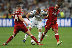Liverpool's Jordan Henderson (left) and Roberto Firmino (right) battle for the ball with Real Madrid's Karim Benzema (centre) during the UEFA Champions League Final at the NSK Olimpiyskiy Stadium, Kiev. PRESS ASSOCIATION Photo. Picture date: Saturday May 26, 2018. See PA story SOCCER Champions League. Photo credit should read: Mike Egerton/PA Wire
