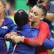 Gymnastics - Olympics: Day 10  Simone Biles #391 of the United States congratulates her team mate Lauren Hernandez #393 of the United States after performing her routine which won her the silver <br />  medal in the Women's Balance Beam Final during the Artistic Gymnastics competition at the Rio Olympic Arena on August 15, 2016 in Rio de Janeiro, Brazil. (Photo by Tim Clayton/Corbis via Getty Images)