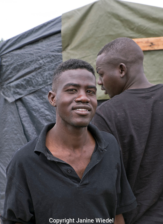 Portrait of young refugee from Sudan living in The Calais Jungle Refugee and Migrant Camp in France