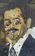 A mural of Saddam Hussein at the entrance of the regime's infamous Abu Ghraib prison..Baghdad, Iraq. 28 April 2003..Photo © J.B. Russell