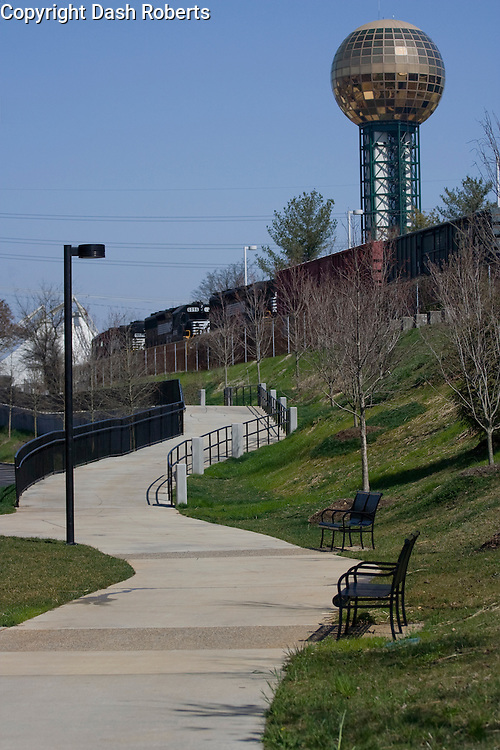 A Greenway trail winds through Knoxville, Tennessee with the Sunsphere in the background.
