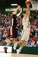 Rice's Alex Bond (30) leaps for a lay up during the boys high school semi final basketball game between the Rutland Raiders and the Rice Green Knights at Patrick Gym on Saturday afternoon February 27, 2016 in Burlington. (BRIAN JENKINS/for the FREE PRESS)