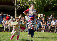 "Sadie Devoid doing the ""fancy shawl"" dance and Katie Devoid doing the ""jingle dance"" of the Ojibwe People during Laconia's Multi Cultural Festival on Saturday.  (Karen Bobotas/for the Laconia Daily Sun)"