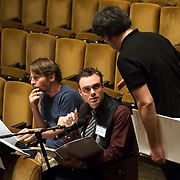 June 3, 2014 - New York, NY : Composer Andrew McManus, center, works with mentor composer Steven Mackey, left, and Philharmonic Music Director Alan Gilbert, right, during a rehearsal of McManus's composition by the New York Philharmonic at Avery Fisher Hall on Tuesday. Three works by little-known composers, such as McManus, will be selected for inclusion in the New York Philharmonic's Biennial. CREDIT: Karsten Moran for The New York Times
