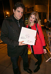 Repro Free: 24/10/2014<br /> Harry and Amra Kantas are pictured with their copy of the new U2 album on Vinyl signed by Bono and The Edge as they arrived for the Late Late Show at the RT&Eacute; studios. Picture Andres Poveda