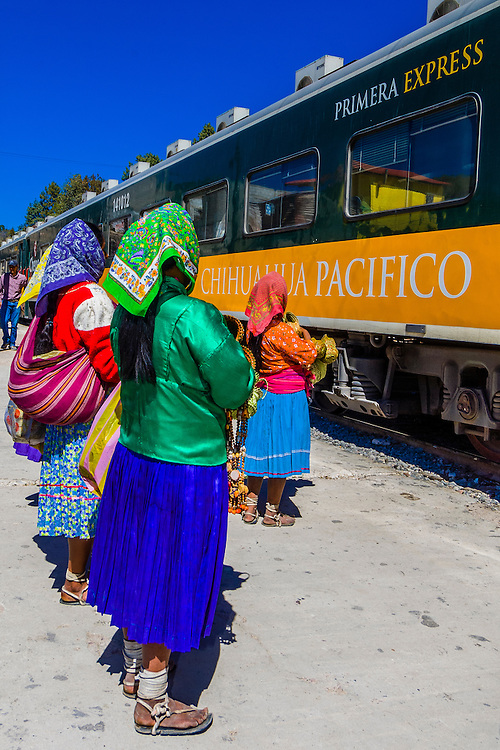Tarahumara women selling handwoven baskets, The Chihuahua al Pacifico railroad (Chepe) train at San Rafael, Copper Canyon, Mexico
