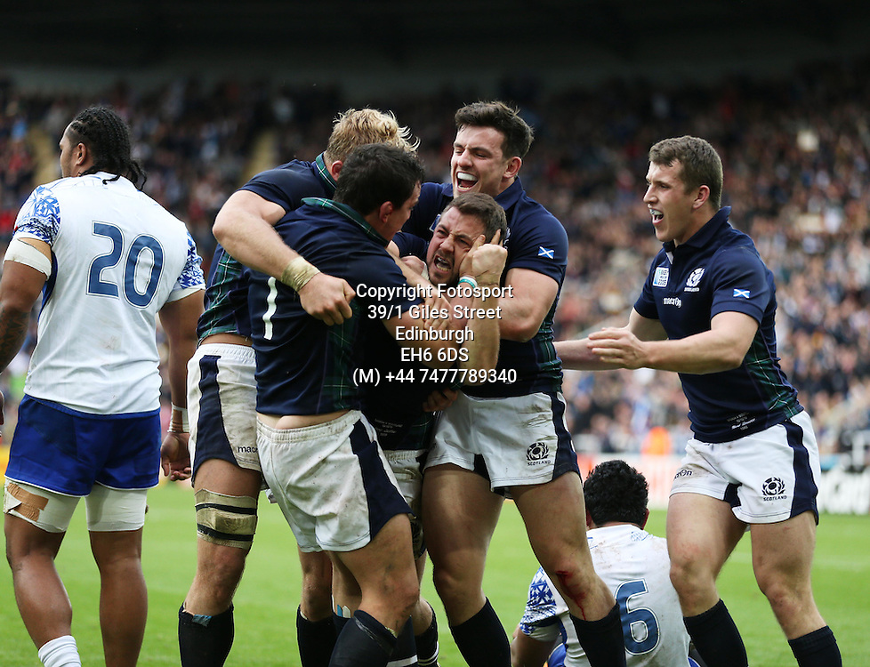 Greig Laidlaw - Scotland captain crashes over the line for the match winning try, flanked by John Hardie (L) and Matt Scott and Mark Bennett (R) late in the game to take Scotland into the quarter finals of the Rugby World Cup.<br />Scotland v Samoa, Rugby World Cup, Pool B, St James' Park, Newcastle, England, Saturday 10 October 2015<br />***PLEASE CREDIT: FOTOSPORT/DAVID GIBSON***<br /><br /><br />Scotland v Samoa, Rugby World Cup, Pool B, St James' Park, Newcastle, England, Saturday 10 October 2015<br />***PLEASE CREDIT: FOTOSPORT/DAVID GIBSON***