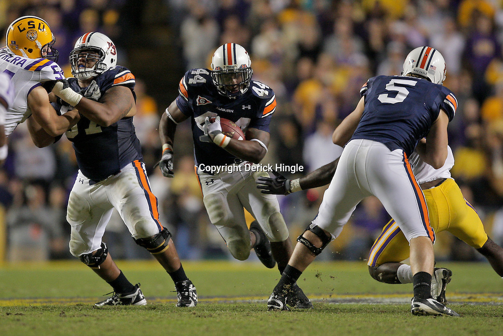 Oct 24, 2009; Baton Rouge, LA, USA; Auburn Tigers running back Ben Tate (44) runs with the ball against the LSU Tigers during the second half at Tiger Stadium. LSU defeated Auburn 31-10. Mandatory Credit: Derick E. Hingle-US PRESSWIRE