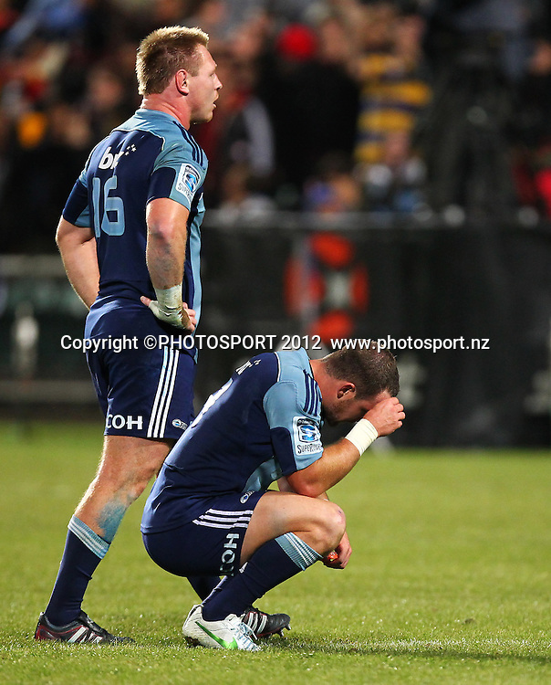 Dejected Blues players Alby Mathewson and Tom McCartney after the loss during the Super Rugby game between The Blues and The Chiefs, North Harbour Stadium, Auckland, New Zealand, Saturday June 2nd 2012. Photo: Simon Watts / photosport.co.nz