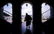 FEB 24, 2001 - SAN CRISTOBAL DE LAS CASAS, CHIAPAS, MEXICO: A Mayan Indian women walks through the Municipal Palace (city hall) in San Cristobal de las Casas, Chiapas, Mexico.  © Jack Kurtz   INDIGENOUS  WOMEN  POVERTY    TOURISM