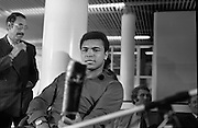 Muhammad Ali In Dublin..1972..11.07.1972..07.11.1972..11th July 1972..Prior to his fight against Al 'Blue' Lewis at Croke Park ,Dublin, former World Heavyweight Champion,Muhammad Ali arrives at Dublin Airport..The fight was part of his build up for for a championship fight against the current World Champion, 'Smokin'  Joe Frazier. Ali had been stripped of the title partly due to his refusal to join the American military during The Vietnam War,which he had opposed...Image of Muhammad Ali as he examines a Shilleagh which was presented to him on his arrival in Dublin.