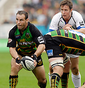 Northampton, GREAT BRITAIN, Saints Mark ROBINSON, looks for a free player to pass to Baths Nick WALSHE looks on during the  Northampton Saints vs Bath Rugby, Guinness Premiership Rugby match, at  Franklin's Gardens, Northampton, ENGLAND on 16/09/2006 [Photo, Peter Spurrier/Intersport-images].