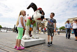 "© Licensed to London News Pictures. 29/06/2013. Bristol, UK. ""Salty Sea Dog"", designed by Peter Lord, one of the Gromit Unleashed sculptures are placed around Bristol, this one by Cascade Steps.  From Monday 1st July, Bristol will be home to 80 iconic giant Gromit sculptures as our public arts trail Gromit Unleashed takes to the streets.  The 5 foot high sculptures which have been painted by artists will be placed in various locations around Bristol and will eventually be auctioned for charity.  All proceeds from Gromit Unleashed will benefit Wallace & Gromit's Grand Appeal, the Bristol Children's Hospital Charity.  Gromit is a character from the popular Aardman Animation series of films and was designed by Nick Park.  29 June 2013.<br /> Photo credit : Simon Chapman/LNP"