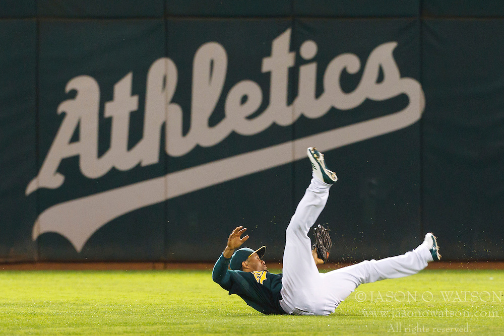September 20, 2011; Oakland, CA, USA;  Oakland Athletics center fielder Coco Crisp (4) makes a diving catch in centerfield against the Texas Rangers during the second inning at O.co Coliseum.  Texas defeated Oakland 7-2.