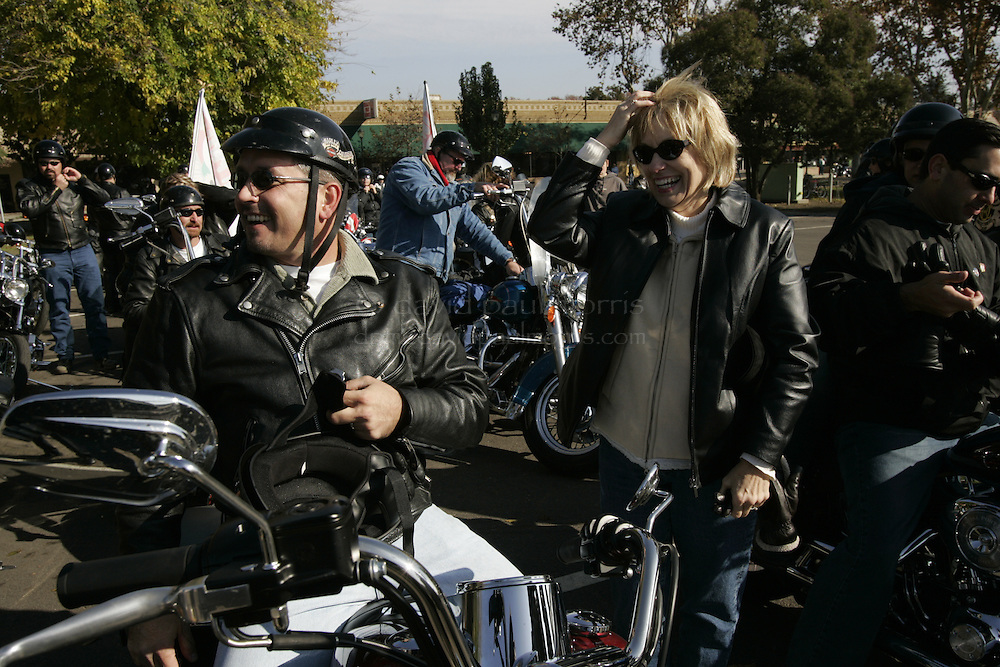 Modesto, CA - NOVEMBER 20:  Shawn Rocha, Laci Peterson's cousin and her mother Sharon Rocha (R) share a laugh after they arrive in Escalon, California. Over 2,000 people take part in the second annual Laci Peterson Memorial Motorcycle ride in Modesto, California on Saturday November 20, 2004. Laci was murdered along with her unborn son, Conner in December 2002 by her husband Scott Peterson who was found guilty of  first degree of murder by a San Mateo, California jury on November 12, 2004 and could face the death penalty. Photograph by David Paul Morris