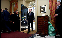 British Prime Minister David Cameron walks through the No10 door after meeting the  former Prime Minister Baroness Thatcher inside Number 10 Downing Street, Tuesday June 8, 2010. Photo By Andrew Parsons/ i-Images